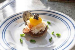 B 5. quail egg and lump crab meat on blini